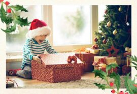 Child opening presents at Christmas time